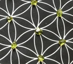 flower of life crystal grid with peridot